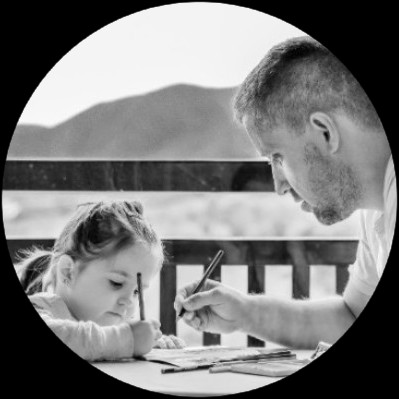 A father helping his daughter to learn multiplication facts.