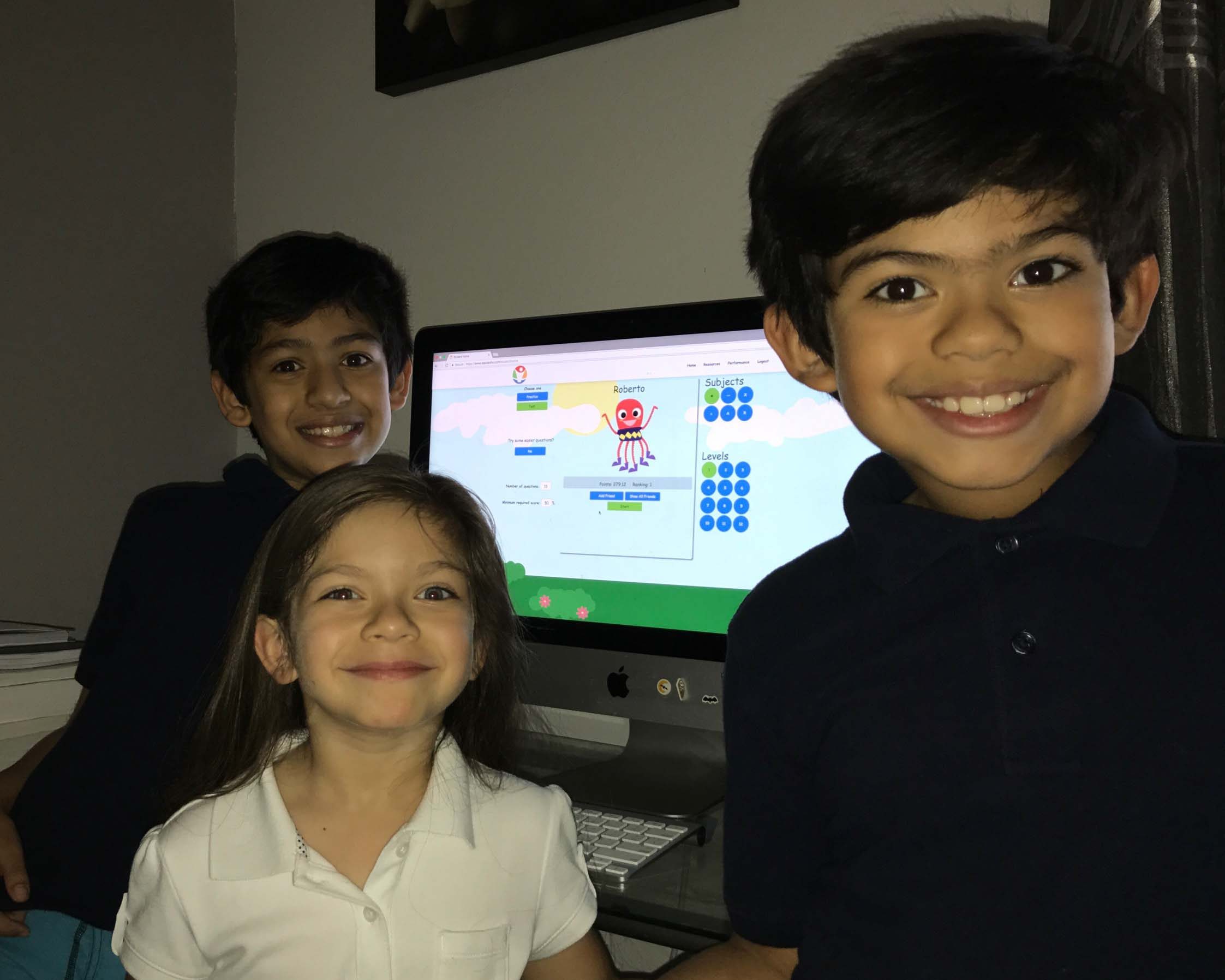 Kids having fun doing basic math practice on Sqooasha.